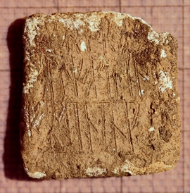 A piece of lead with runic writing found on a site at Lurekalven.