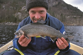 Sports fisherman Trond Hohansen with a char in Lake Skogseidvatnet.