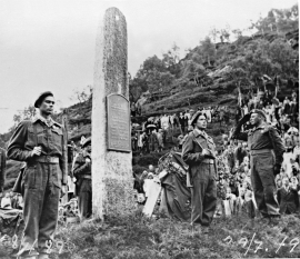 Crown Prince Olav unveiling the memorial stone over the fallen from Bjørn West in Stordalen, 1949.
