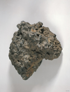 A lump of slag from iron melting.