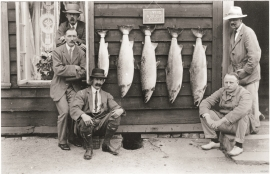Fish Lords show off the day's catch at Hotel Monsen, Evanger, in 1912.
