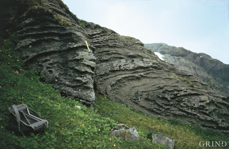 Folded limestone with a layer of slate neat Veigvatn