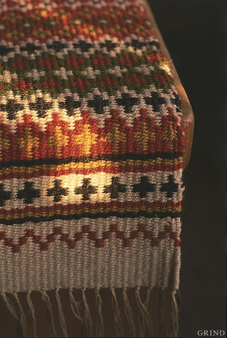 Characteristic details from the wrap-weighted loom technique.