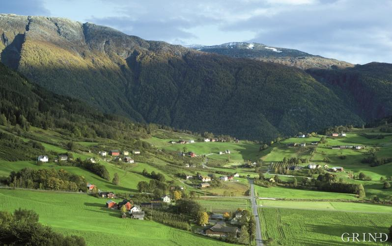 The well cared for agricultural area in Ulvik has become the landscape of the tractor